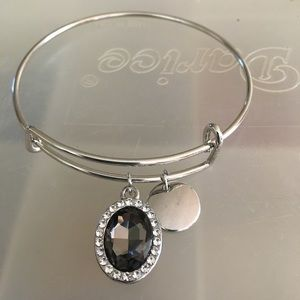 Silver bracelet with two charms